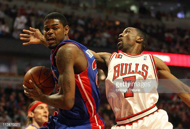 The Chicago Bulls' Ben Gordon tries the get the ball away from the Detroit Pistons' Amir Johnson during fourth quarter action The Bulls defeated the...