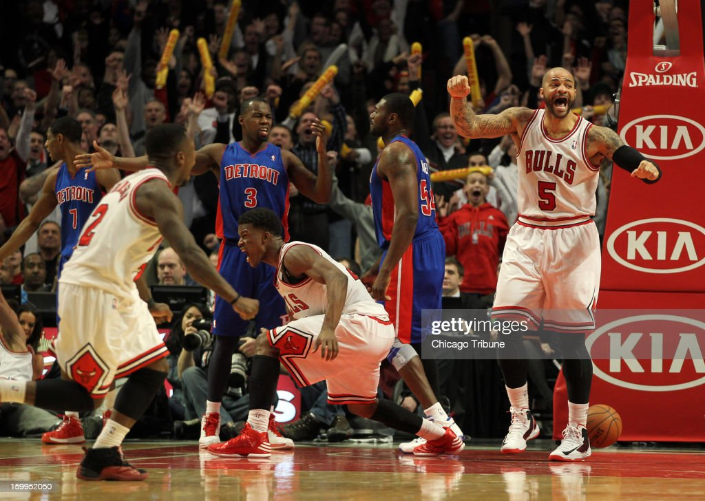 The Chicago Bulls' Carlos Boozer, Jimmy Butler and Nate Robinson and Detroit Pistons' Rodney Stuckey react to Marco Belinelli's game-winning basket during the Bulls' 85-82 win at the United Center in Chicago, Illinois, Wednesday, January 23, 2013.
