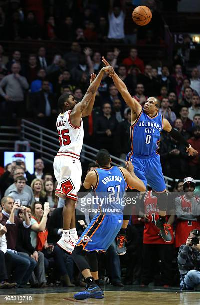 The Chicago Bulls' E'Twaun Moore hits the gamewinner over the Oklahoma City Thunder's Russell Westbrook at the United Center in Chicago on Thursday...