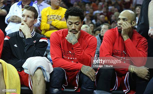 The Chicago Bulls' from left Mike Dunleavy Derrick Rose and Taj Gibson sit on the bench in the final seconds of a 10691 loss against the Cleveland...