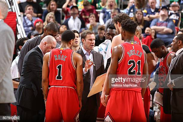 The Chicago Bulls huddle around Fred Hoiberg of the Chicago Bulls to discuss their next play during the game against the Utah Jazz on February 1 2016...