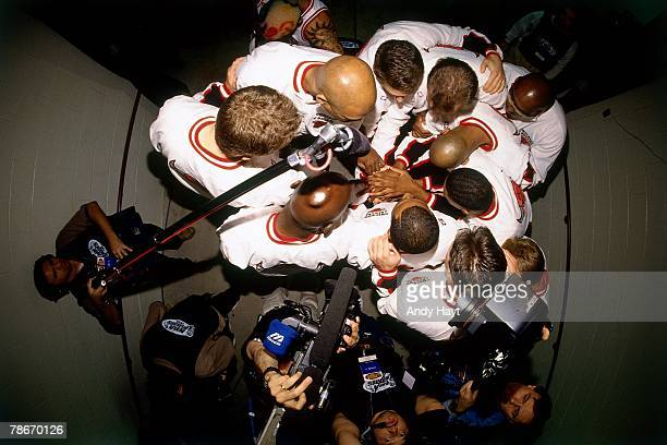 The Chicago Bulls huddle up before taking the court against the Seattle SuperSonics in Game Two of the 1996 NBA Finals at the United Center on June 7...