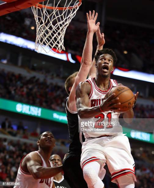 The Chicago Bulls' Jimmy Butler soars to the basket against the Brooklyn Nets at the United Center in Chicago on April 12 2017 The Bulls traded...