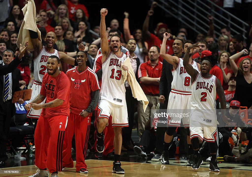 The Chicago Bulls' Joakim Noah (13) and Nate Robinson (2) lead the celebration in the final seconds of the third overtime of a 142-134 win against the Brooklyn Nets on Saturday, April 27, 2013, in Game 4 of the Eastern Conference Playoffs first-round series at the United Center in Chicago, Illinois.