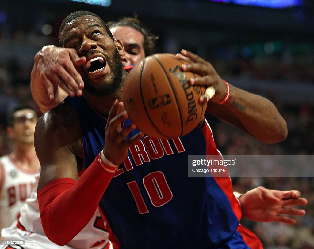 The Chicago Bulls' Joakim Noah fouls the Detroit Pistons' Greg Monroe (10) in the third quarter on Friday, April 11, 2014, at the United Center in Chicago. The Bulls won, 106-98.
