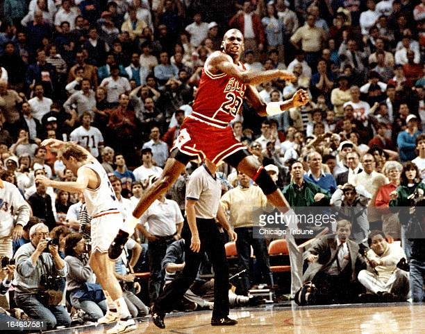 The Chicago Bulls' Michael Jordan reacts after hitting the gamewinning basket over Cleveland's Craig Ehlo left rear in Game 5 of the NBA playoffs May...