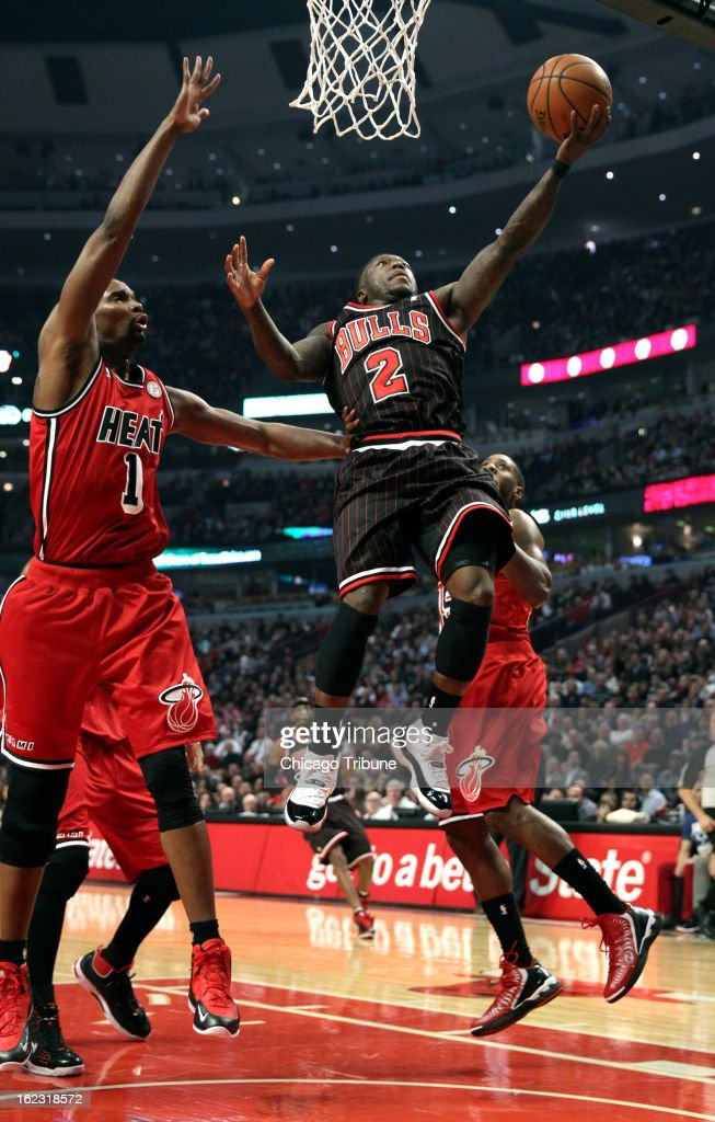 The Chicago Bulls' Nate Robinson (2) drives to the hoop in the first quarter against the Miami Heat at the United Center in Chicago, Illinois, on Thursday, February 21, 2013. The Heat stifled the Bulls, 86-67.
