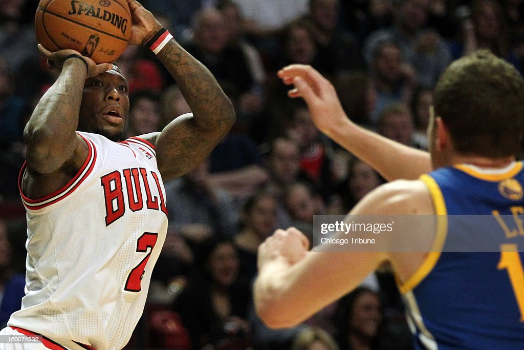 The Chicago Bulls' Nate Robinson (2) looks to take a shot as the Golden State Warriors' David Lee defends during the first half at the United Center in Chicago, Illinois, on Friday, January 25, 2013. The Bulls defeated the Warriors, 103-87.