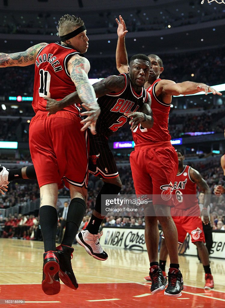 The Chicago Bulls' Nate Robinson (2) makes a pass around the Miami Heat's Chris Andersen (11) in the first quarter at the United Center in Chicago, Illinois, on Thursday, February 21, 2013. The Heat stifled the Bulls, 86-67.
