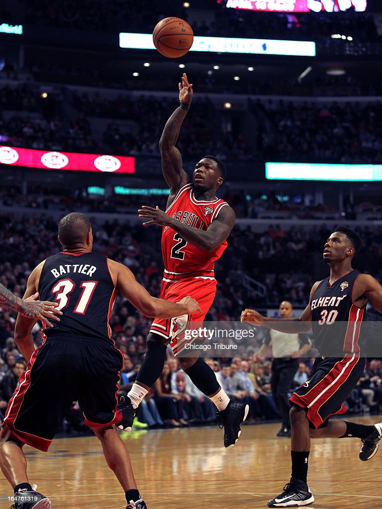 The Chicago Bulls' Nate Robinson scores over the Miami Heat's Shane Battier in the first quarter at United Center in Chicago, Illinois, on Wednesday, March 27, 2013.