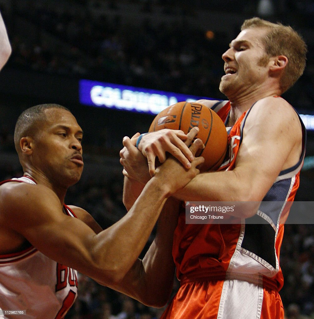 The Chicago Bulls P J Brown left battles for the ball wi