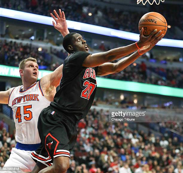 The Chicago Bulls' Tony Snell goes to the basket past the New York Knicks' Cole Aldrich during the first half at the United Center in Chicago on...
