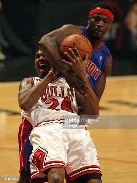 The Chicago Bulls' Tyrus Thomas battles for the ball with the Detroit Pistons' Kwame Brown on his way to the basket during the first quarter The...