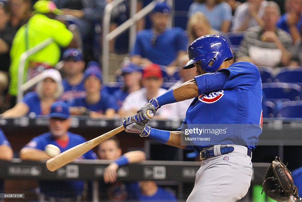 The Chicago Cubs' Addison Russell singles in the first inning against the Miami Marlins on Friday, June 24, 2016, at Marlins Park in Miami.