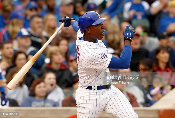 The Chicago Cubs' Alfonso Soriano watches the flight of his double to center field against the Pittsburgh Pirates at Wrigley Field in Chicago...