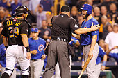 The Chicago Cubs and Pittsburgh Pirates benches clear after Jake Arrieta of the Chicago Cubs is hit by a pitch thrown by Tony Watson of the...