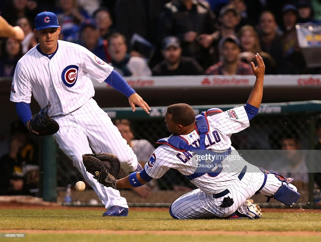The Chicago Cubs' Anthony Rizzo and catcher Welington Castillo, right, are unable to catch a foul pop by the Pittsburgh Pirates' Russell Martin in the second inning at Wrigley Field in Chicago on Wednesday, April 9, 2014.