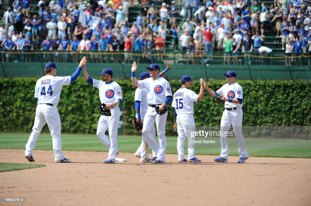 The Chicago Cubs celebrate a win against the New York Mets on May 18, 2013 at Wrigley Field in Chicago, Illinois. The Chicago Cubs defeated New York Mets 8-2.