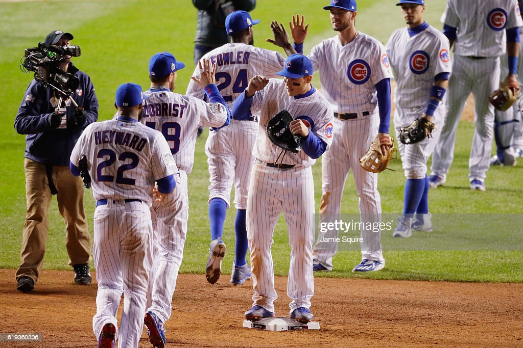 The Chicago Cubs celebrate after beating the Cleveland Indians 3-2 in Game Five of the 2016 World Series at Wrigley Field on October 30, 2016 in Chicago, Illinois.
