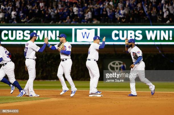 The Chicago Cubs celebrate after beating the Los Angeles Dodgers 32 in game four of the National League Championship Series at Wrigley Field on...