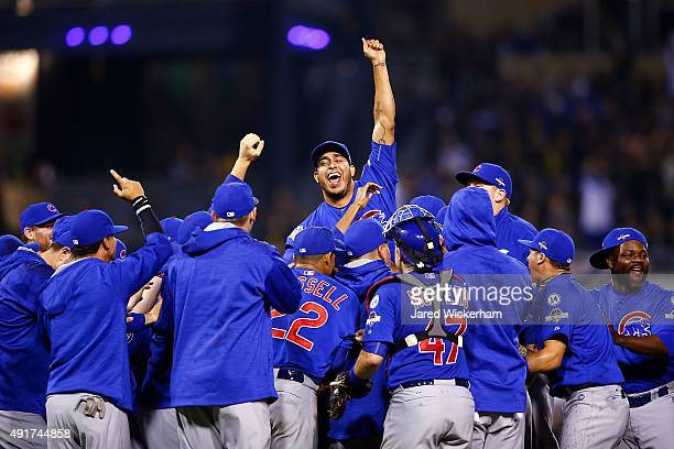 The Chicago Cubs celebrate defeating the Pittsburgh Pirates to win the National League Wild Card game at PNC Park on October 7 2015 in Pittsburgh...