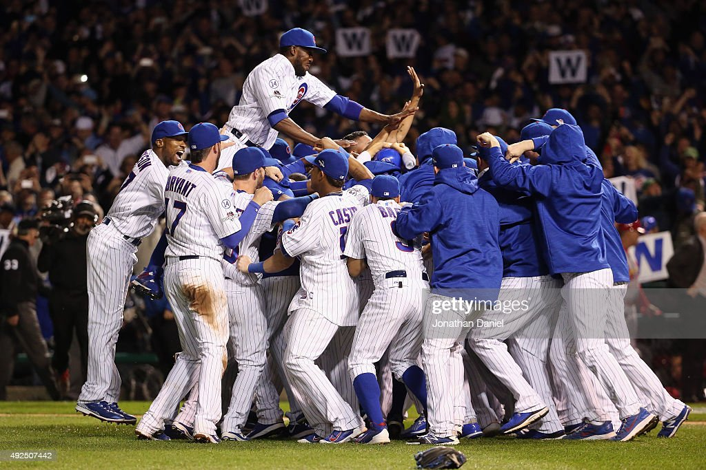 The Chicago Cubs celebrate defeating the St. Louis Cardinals 6-4 in game four of the National League Division Series at Wrigley Field on October 13, 2015 in Chicago, Illinois.