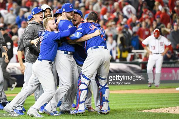 The Chicago Cubs celebrate following game five of the NLDS between the Chicago Cubs and the Washington Nationals on October 12 at Nationals Park in...
