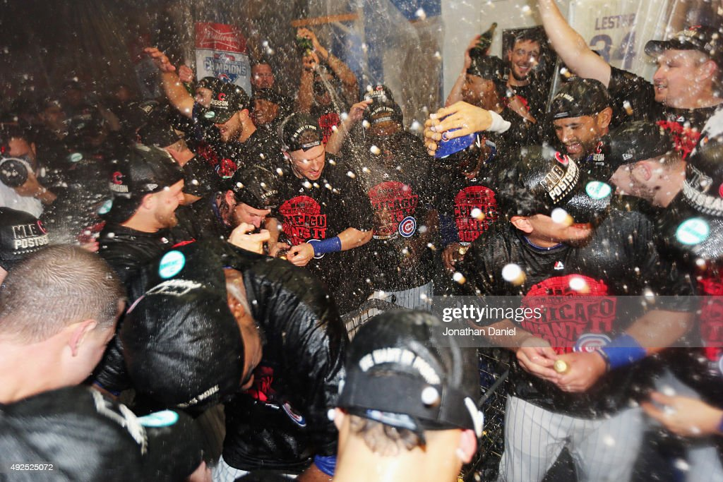 The Chicago Cubs celebrate in the clubhouse after defeating the St. Louis Cardinals in game four of the National League Division Series to win the NLDS 3-1 at Wrigley Field on October 13, 2015 in Chicago, Illinois. The Chicago Cubs defeat the St. Louis Cardinals with a score of 6 to 4.