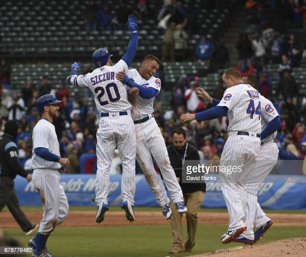 The Chicago Cubs celebrate their walkoff win against the Philadelphia Phillies in the thirteenth inning on May 4 2017 at Wrigley Field in Chicago...