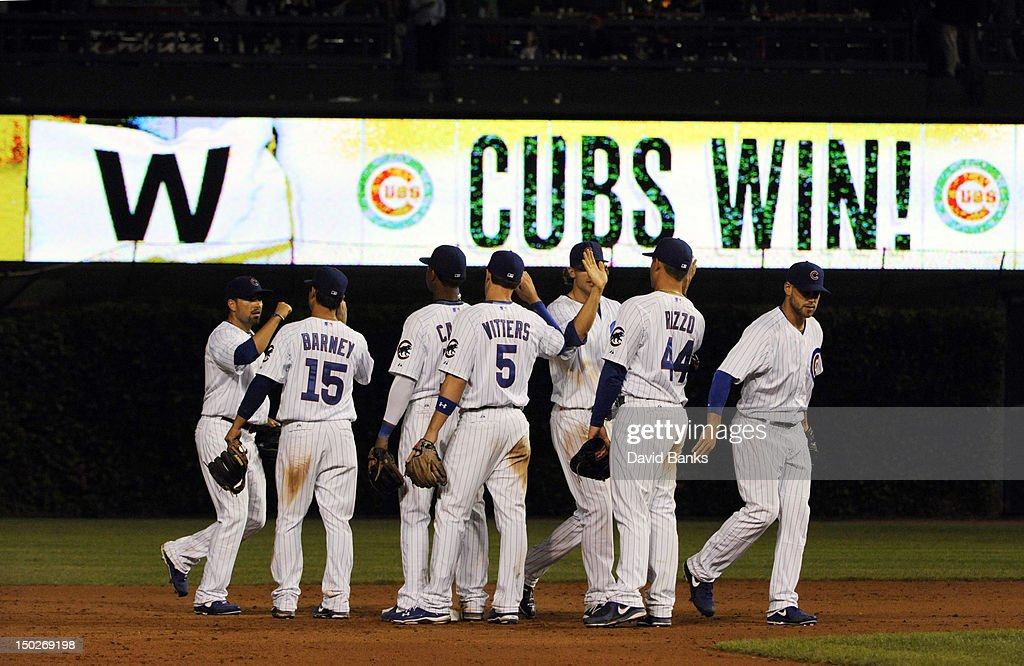 The Chicago Cubs celebrate their win against the Houston Astros on August 13, 2012 at Wrigley Field in Chicago, Illinois. the Chicago Cubs defeated the Houston Astros 7-1.