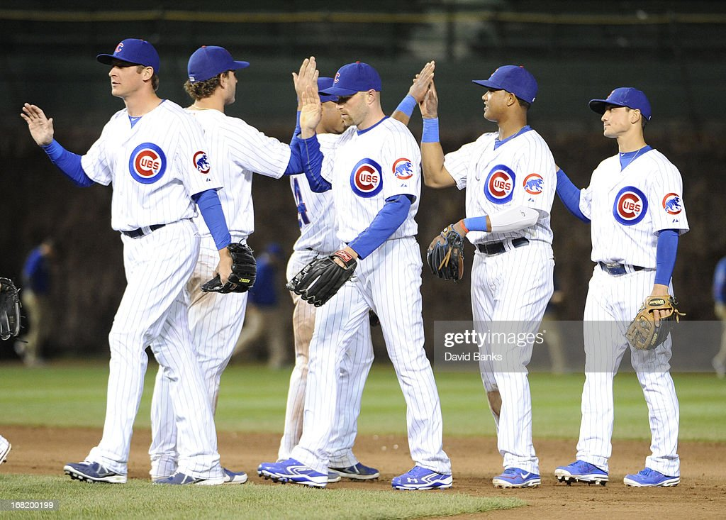 The Chicago Cubs celebrate their win against the Texas Rangers on May 6, 2013 at Wrigley Field in Chicago, Illinois. The Chicago Cubs defeated the Texas Rangers 9-2.
