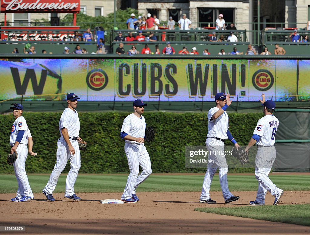 The Chicago Cubs celebrate their win on September 1, 2013 at Wrigley Field in Chicago, Illinois. The Chicago Cubs defeated the Philadelphia Phillies 7-1.