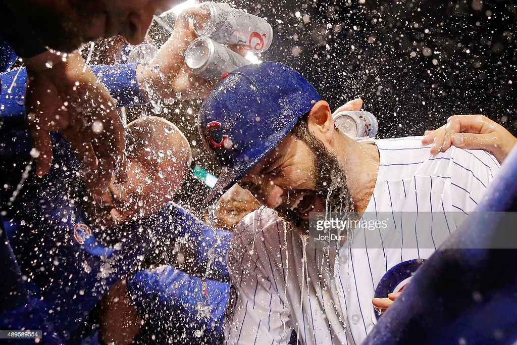 The Chicago Cubs celebrate with Jake Arrieta #49 on his 20th win of the season against the Milwaukee Brewers at Wrigley Field on September 22, 2015 in Chicago, Illinois. The Chicago Cubs won 4-0.