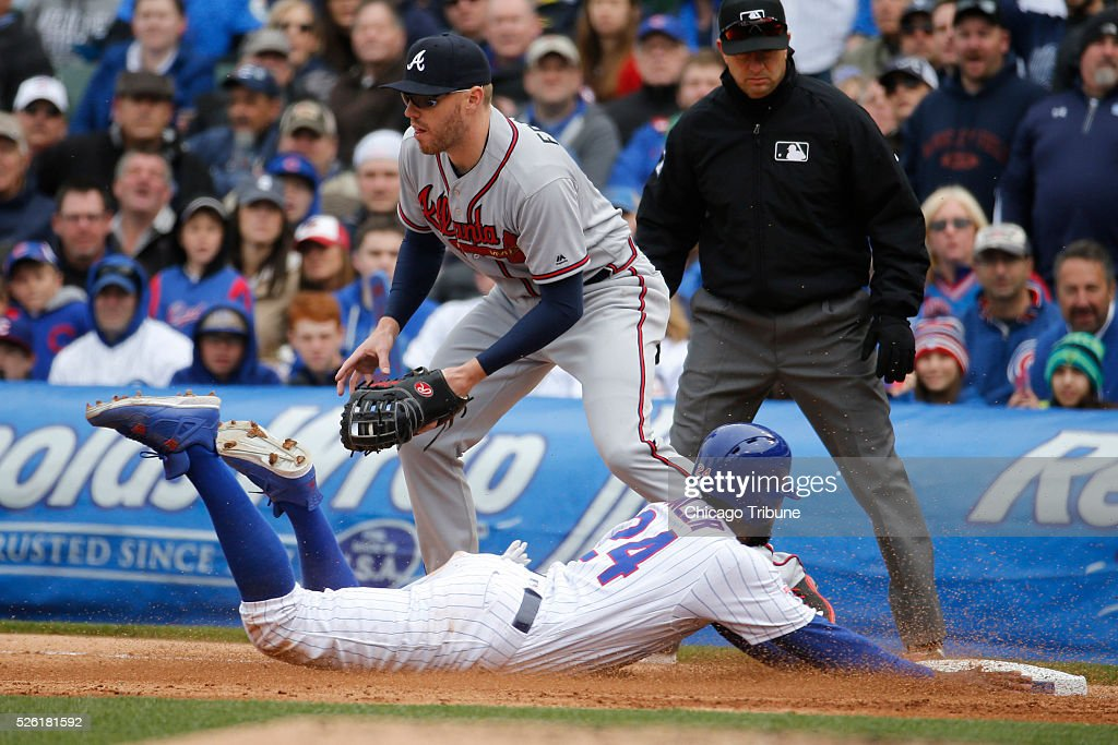The Chicago Cubs' Dexter Fowler (24) is out on a double play as Atlanta Braves first baseman Freddie Freeman makes the play in the sixth inning at Wrigley Field in Chicago on Friday, April 29, 2016. The Cubs won, 6-1.