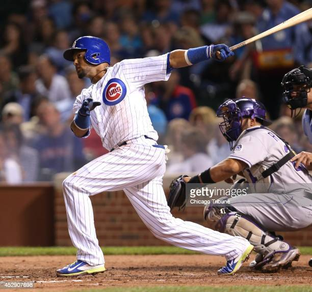The Chicago Cubs' Emilio Bonifacio hits a tworun home run in the fourth inning against the Colorado Rockies at Wrigley Field in Chicago on Tuesday...