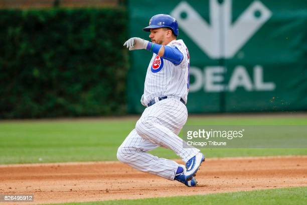 The Chicago Cubs' Kyle Schwarber slides safely into second base with a double in the seventh inning against the Washington Nationals at Wrigley Field...
