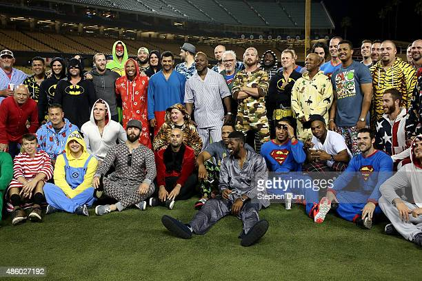 The Chicago Cubs pose for a team photo as they wear pajamas as part of a theme trip as they prepare to leave town after the game against the Los...