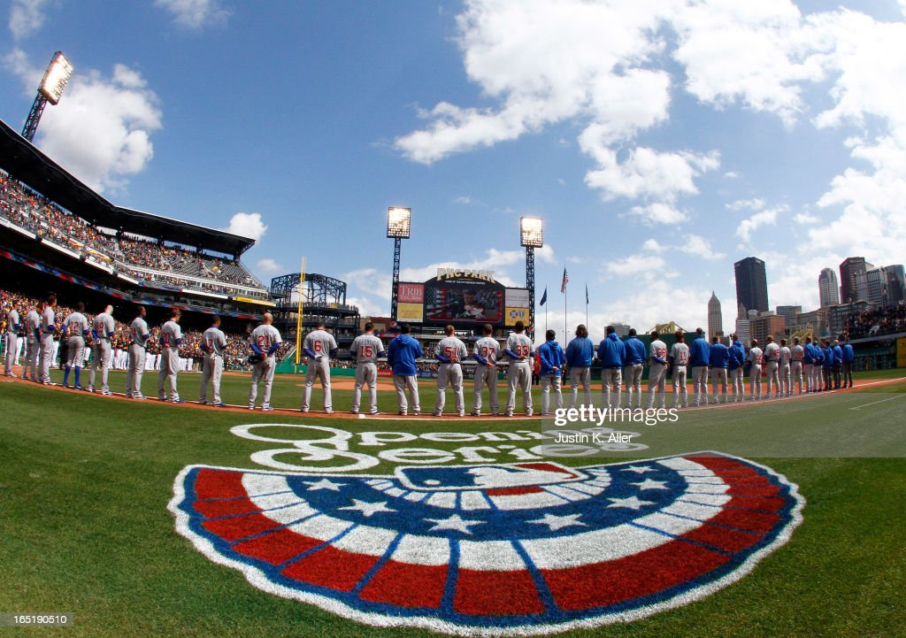 The Chicago Cubs stand during pre-game ceremonies before the opening day game against the Pittsburgh Pirates on April 1, 2013 at PNC Park in Pittsburgh, Pennsylvania.