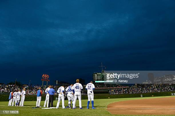 The Chicago Cubs stand on the field during the singing of ''The Star Spangled Banner'' before the game against the Arizona Diamondbacks at Wrigley...