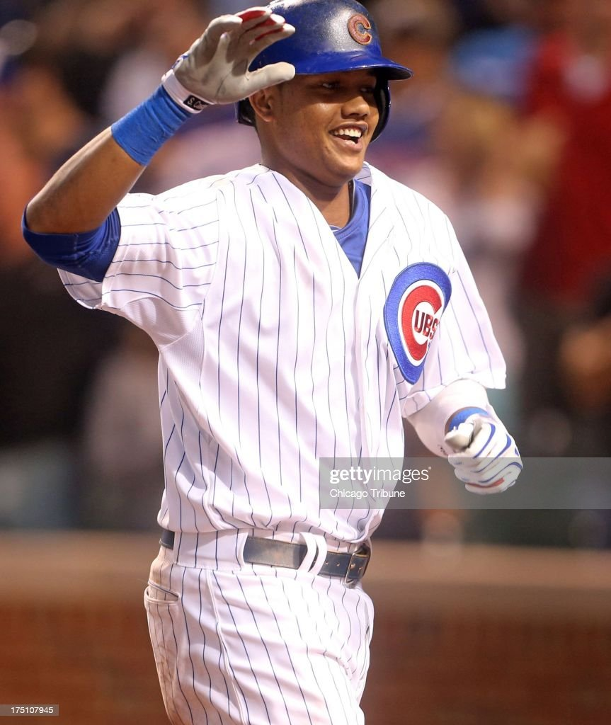 The Chicago Cubs' Starlin Castro celebrates his home run off Milwaukee Brewers starting pitcher Wily Peralta in the fourth inning at Wrigley Field in Chicago, Illinois, on Wednesday, July 31, 2013.