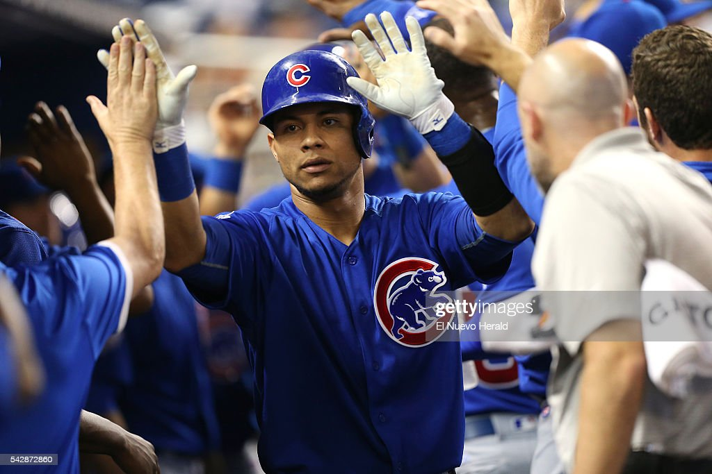 The Chicago Cubs' Willson Contreras is congratulated by teammates after hitting a two-run home run during the first inning against the Miami Marlins on Friday, June 24, 2016, at Marlins Park in Miami.