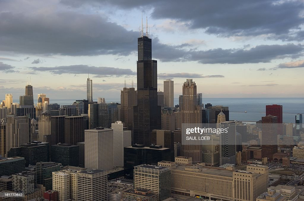 The Chicago, Illinois, downtown skyline including the Willis Tower, formerly known as the Sears Tower, is seen from the air at sunset, February 15, 2013. AFP PHOTO / Saul LOEB