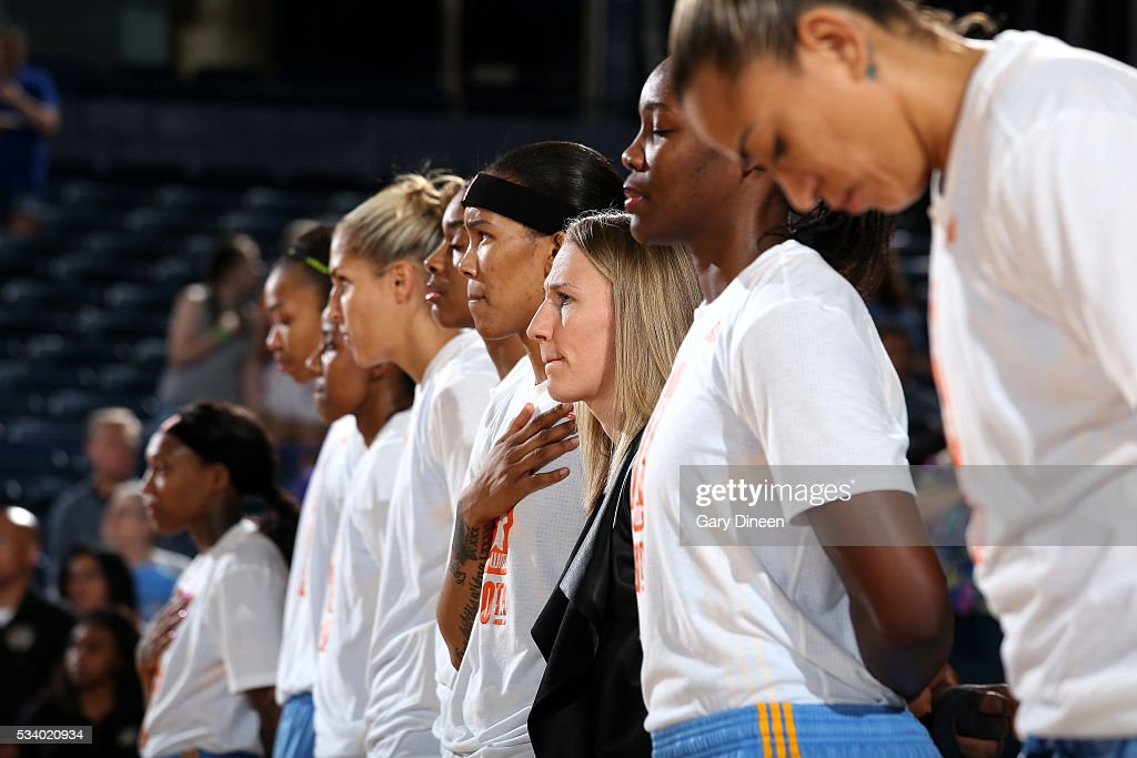The Chicago Sky stand for a moment of silence for the National Anthem before the game against the Los Angeles Sparks on May 24, 2016 at the Allstate Arena in Chicago, Illinois.