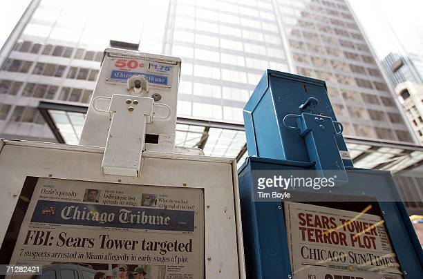 The Chicago Tribune and Chicago SunTimes with headlines about an alledged terror plot sit in newspaper boxes across the street from the Sears Tower...