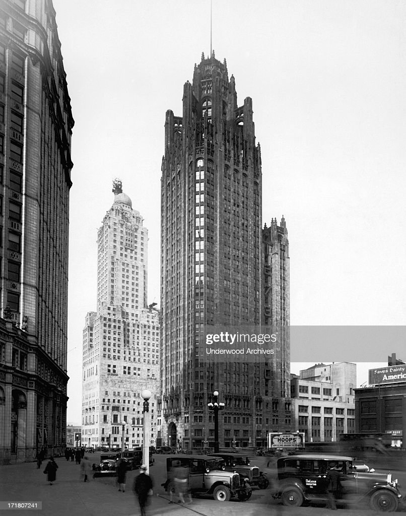 The Chicago Tribune Building with the Wrigley Building at left across Michigan Avenue and the Hotel Intercontinental behind Chicago Illinois 1929