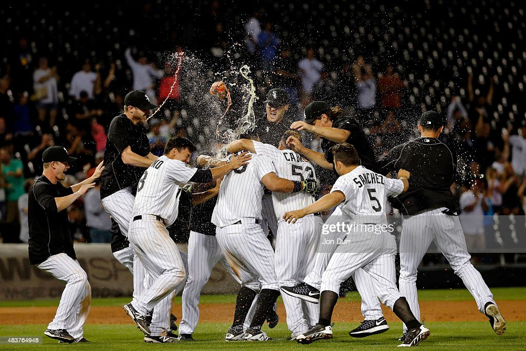 The Chicago White Sox celebrate after Avisail Garcia #26 hit a walkoff one run RBI double against the Los Angeles Angels of Anaheim at U.S. Cellular Field on August 12, 2015 in Chicago, Illinois. The Chicago White Sox won 3-2 in thirteen innings.