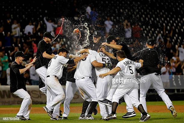 The Chicago White Sox celebrate after Avisail Garcia hit a walkoff one run RBI double against the Los Angeles Angels of Anaheim at US Cellular Field...
