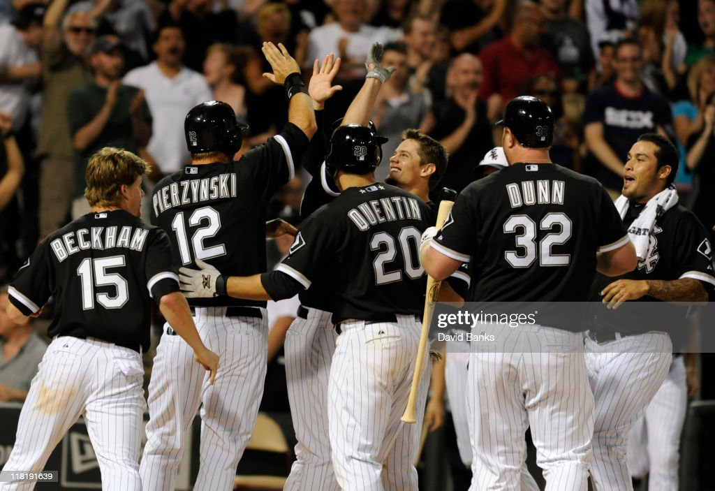 The Chicago White Sox celebrate their victory as <a gi-track='captionPersonalityLinkClicked' href=/galleries/search?phrase=A.J.+Pierzynski&family=editorial&specificpeople=204486 ng-click='$event.stopPropagation()'>A.J. Pierzynski</a> # 12 scores on a balk in the ninth inning against the Kansas City Royals on July 4, 2011 at U.S. Cellular Field in Chicago, Illinois. The White Sox defeated the Royals 5-4.