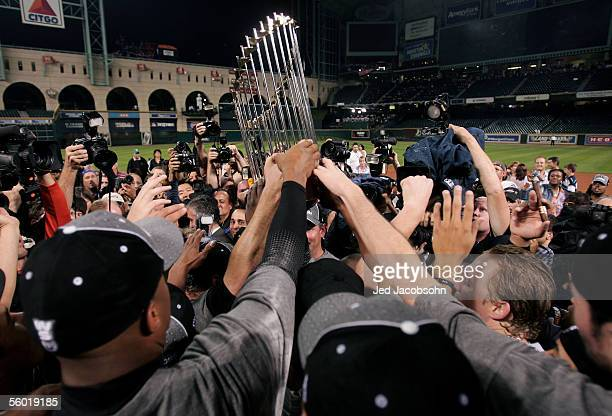 The Chicago White Sox pass around the Championship trophy after winning Game Four of the 2005 Major League Baseball World Series against the Houston...