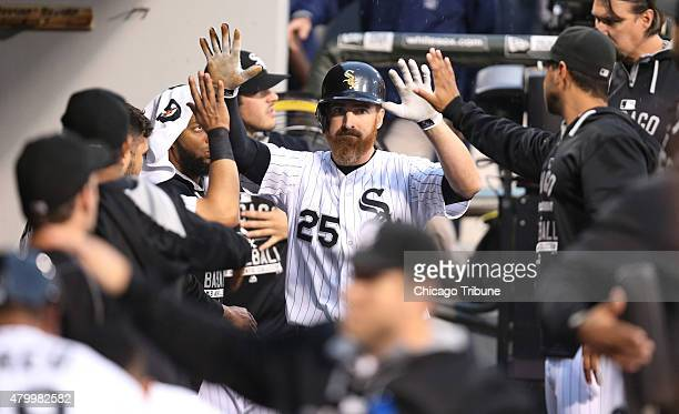 The Chicago White Sox's Adam LaRoche is congratulated by teammates after his tworun double in the first inning against the Toronto Blue Jays at US...